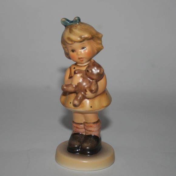 Goebel Hummel Girl w/ teddy bear Cuddles Figurine